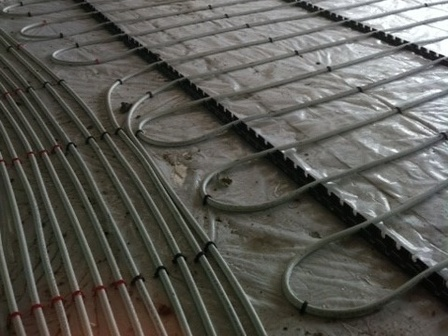 Under floor heating pipes laid out